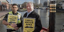 Inspector Imran Mirza of West Midlands Police and Peter Mathews CMG, chair of our West Midlands Waterway Partnership