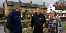 Licence support officers talking to a customer by the canal