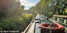 A narrowboat cruises along the Caldon canal