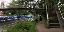 Parent and child walking along towpath beside canal