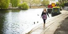 A lady walking alongside the regent's canal