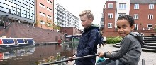 A boy fishing at Birmingham Canal Festival