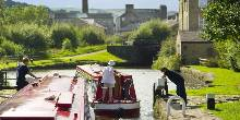 A boater passing through a canal lock in Sowerby Bridge