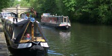 Boats moored on towpath