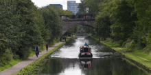A towpath walk alongside a canal and a historic bridge