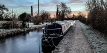 Sunrise photo with iced up boat and canal
