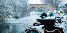 A snow-laden canal boat at Fenny Stratford