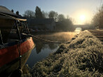 A narrowboat moored in winter on the Grand Union Canal at Tring