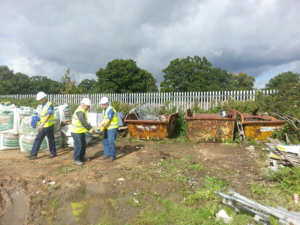 Volunteers clearing metal at one of our units by Amanda Morgan