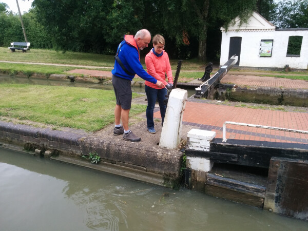 Vince showing a new holiday make how to use the paddle gear, Hillmorton Locks (The busiest flight in the country) North Oxford Canal by Kevin Marriott