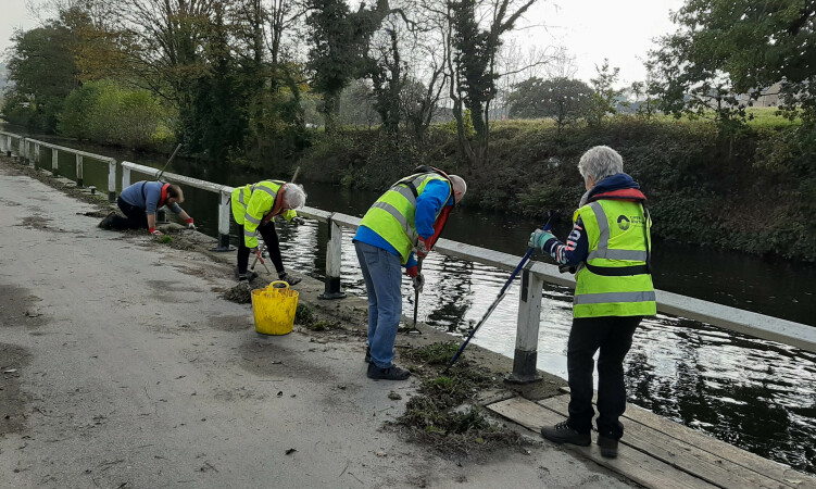Volunteers weeding the drive at Apperley Bridge, Leeds & Liverpool Canal by Dianne Green
